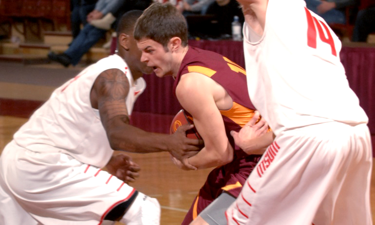 Junior guard Matt Ellingson wrestles for the ball during Concordia's game with MSU Moorhead. (Photo courtesy of Sheldon Green)