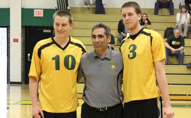 Keuka College's men's volleyball program honored seniors Ryan Kelly (left) and Devin Lesch (right) before Tuesday's four-set loss to SUNYIT. Head coach Ben Guiliano is in the middle (photo courtesy of Carly Volante, Keuka College Sports Information Department).