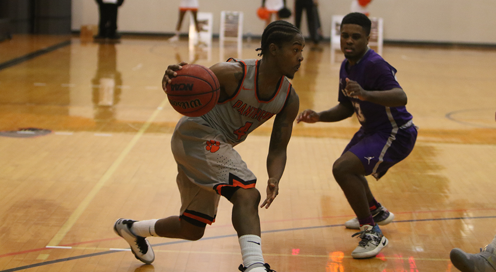 Stevonte Young drives past Fontbonne guard in Saturday's game.