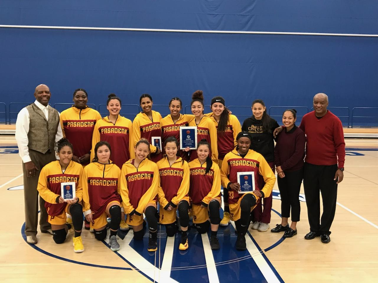 PCC takes a team photo following winning the Crossover Challenge Tournament title Friday night. MVP Dariel Johnson is in the bottom row far right holding her award.