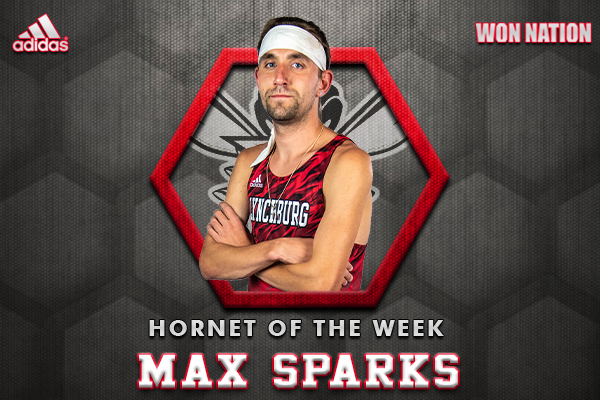 MAX SPARKS IN XC UNIFORM ARMS CROSSED ON HOTW BACKGROUND
