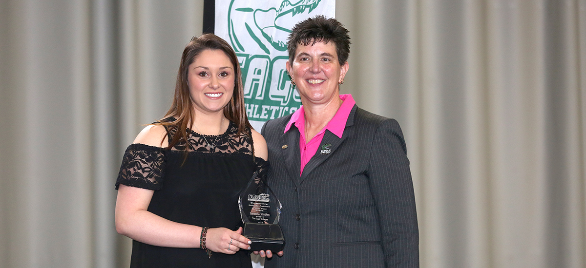 Samantha Trimblett receives her award from Director of Athletics, Sandy Augstein-Collins