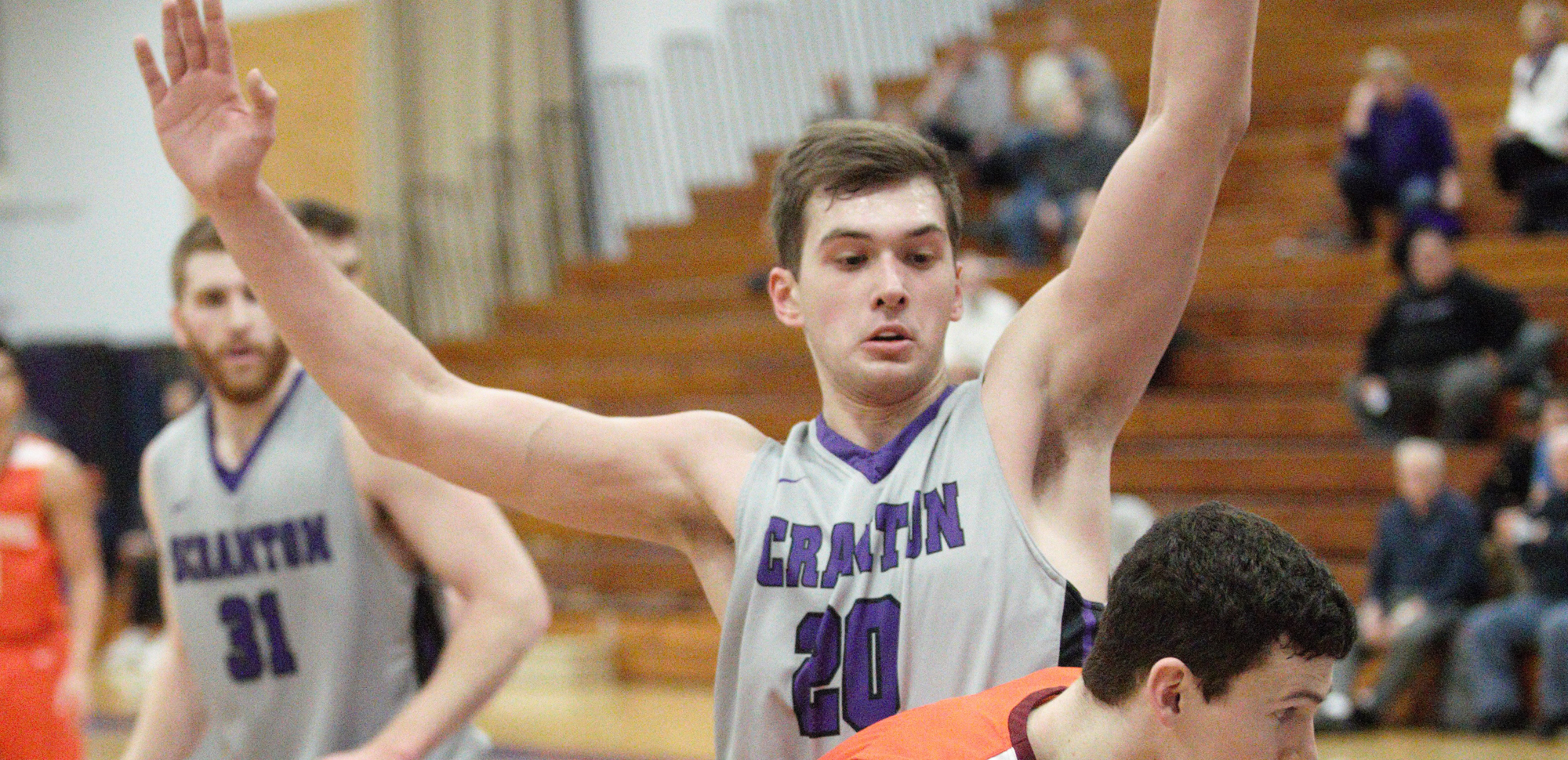 Matthew Mancuso scored 20 points and pulled down 13 rebounds to lead Scranton past Stevenson in Saturday's season opener.
