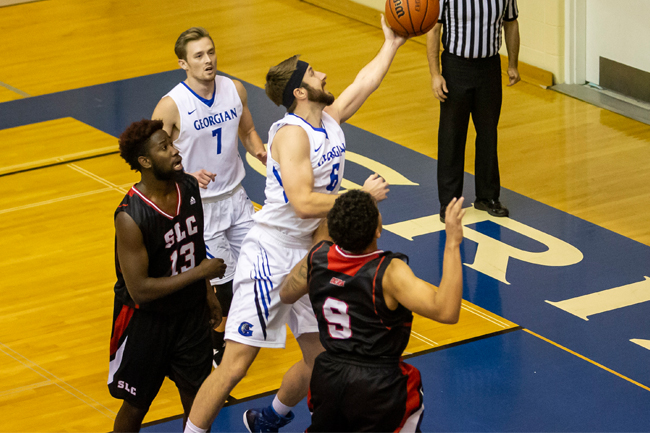MEN'S BASKETBALL DEFEAT VIKINGS IN OVERTIME