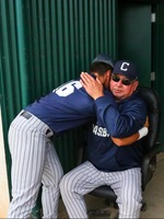 Rollie Nichols shares a moment with retiring head coach Ken Gaylord
