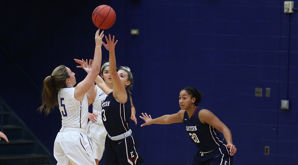 Eastern Connecticut file photo of women's basketball team on defense.