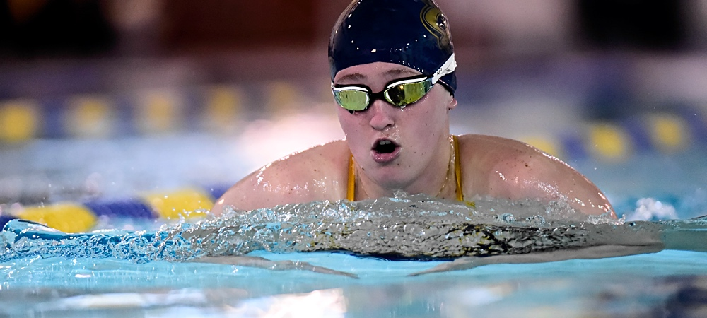 Jana Kiefer swims the breaststroke during a swim meet in the pool.