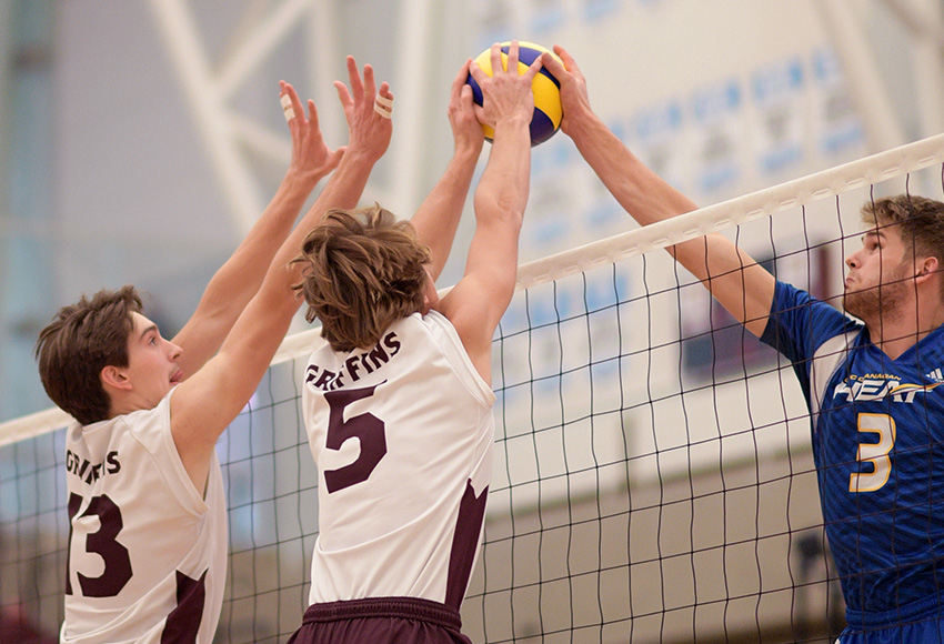 Keenan Koss, left, and Caleb Weiss out-joust UBCO's Max Heppell at the net on Saturday night (Chris Piggott photo).