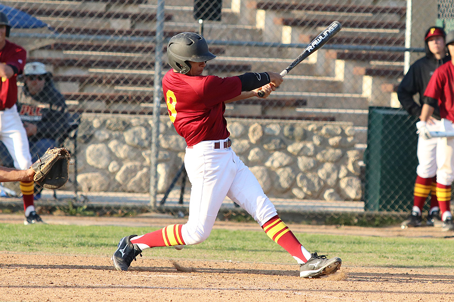 Second baseman Jose Jimenez drives a double to the gap in the eighth inning to help the Lancers to their third straight win on Tuesday, photo by Richard Quinton.
