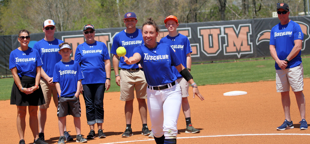 Emily White throws out the first pitch as part of Alopecia Awareness Day. The team wore blue uniforms in honor of Emily.