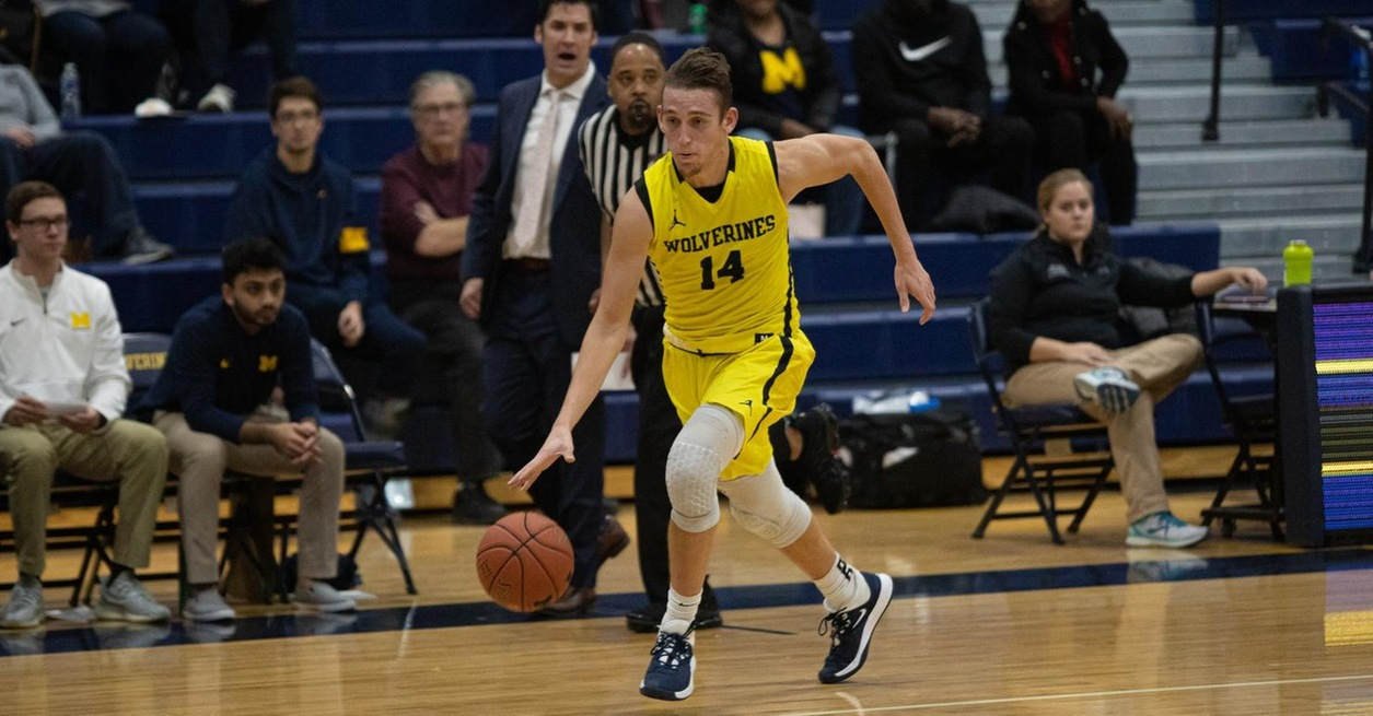 Racers rally late to upset Wolverines