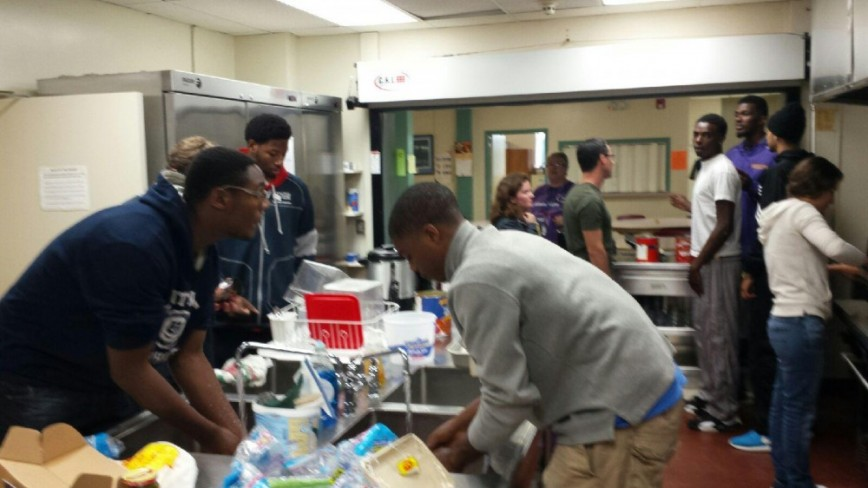 Members of the MCC men's basketball team help serve dinner to the Marshalltown House of Compassion on Friday