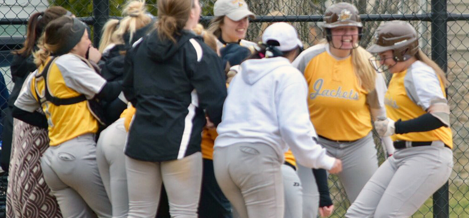 Yellow Jackets celebrate sweep of crosstown rival after Ashley Matousek's game one winning two-run homerun (Photo courtesy of Jeff Boledovic)