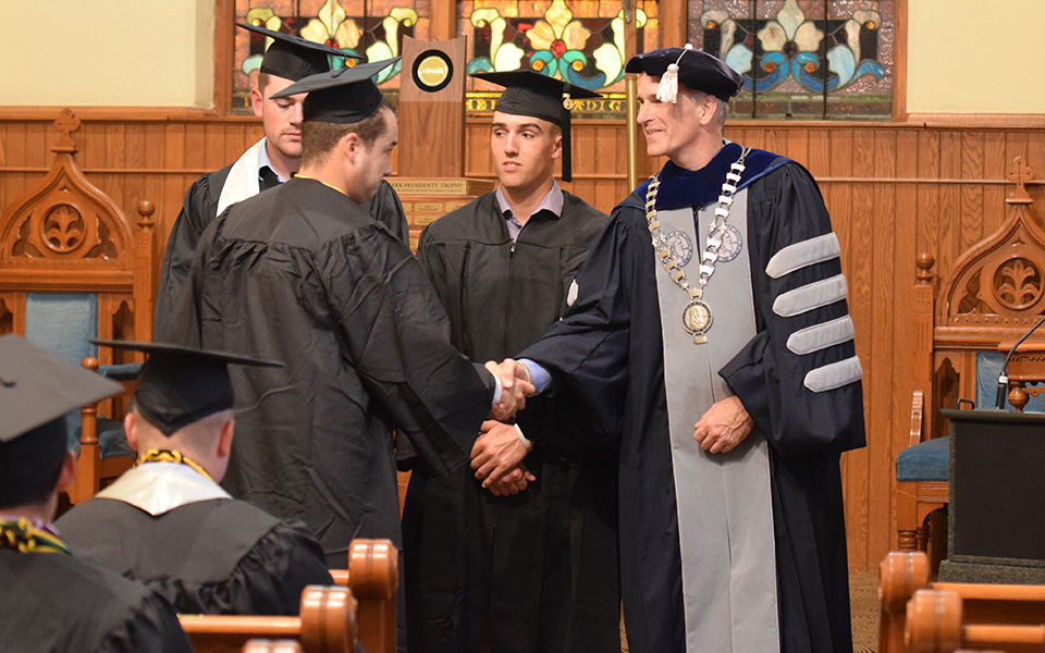 President Bryon L. Grigsby '90 at the 2018 baseball graduation ceremony in Borhek Chapel.