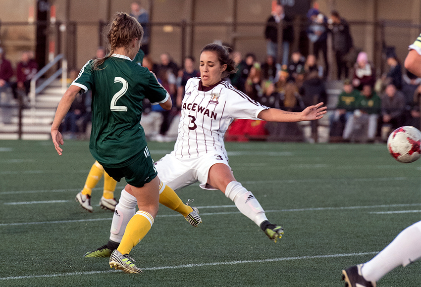 Brittany Costa, seen battling against Alberta's #2 Karissa McNutt, scored the winning goal for MacEwan in extra time on Friday night to deliver a 1-0 win over their cross-town rivals (Chris Piggott photo).