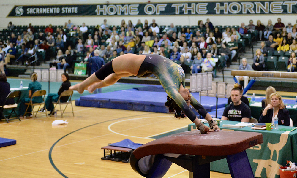 GYMNASTICS SCORES 195.175, PLACES THIRD IN HIGH-POWERED MEET