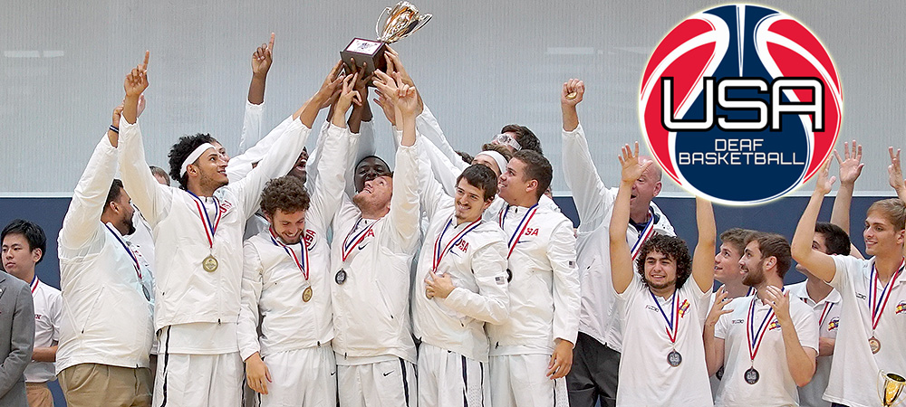 Team USA Men's U21 Basketball Team Celebrates its 2018 World Deaf Basketball Championship. The team stands on a podium with their hands raised holding a trophy. The team is happy.