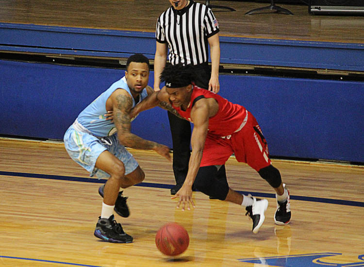 Colby sophomore Xavier Smith guards an Allen Community College player Jan. 24 in the Trojans' 93-85 win at the Community Building.