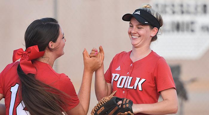 Breanna Snell congratulates winning pitcher Taite Powell after the Eagles beat Florida Southwestern 4-2. (Photo by Tom Hagerty, Polk State.)