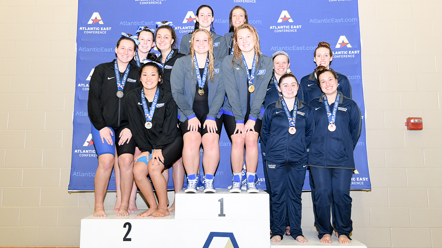 Plumley, Saints combine for three Atlantic East titles in day one of swimming championships