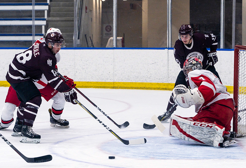 Nicolas Correale, left, and teammate Ryan Baskerville hunt for a loose puck against SAIT's Payton Lee during a game earlier this season. The Griffins scored on the play (Matthew Jacula photo).