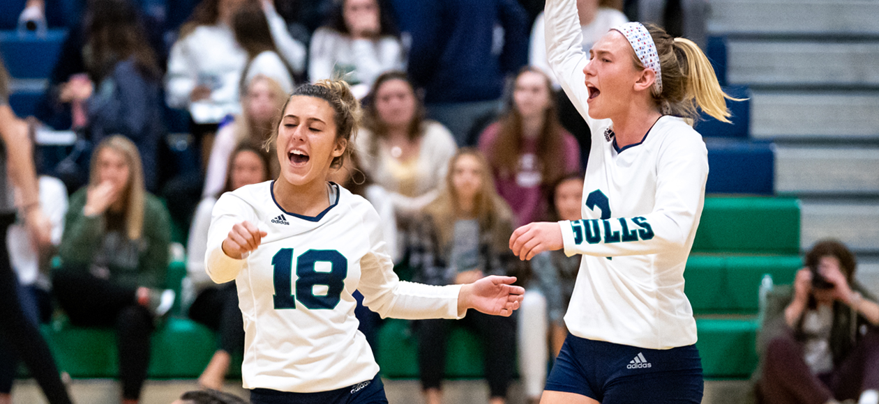 Image of Lauren McGrath and Remi Quesnelle celebrating a point against Roger Williams.