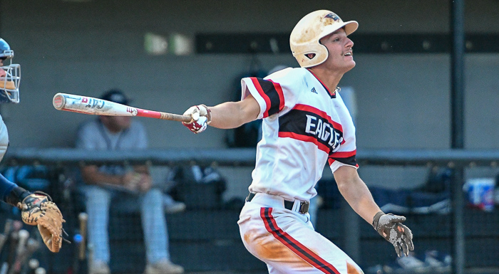 Nico Limoncelli singles in the fifth inning against SCF. (Photo by Tom Hagerty, Polk State.)
