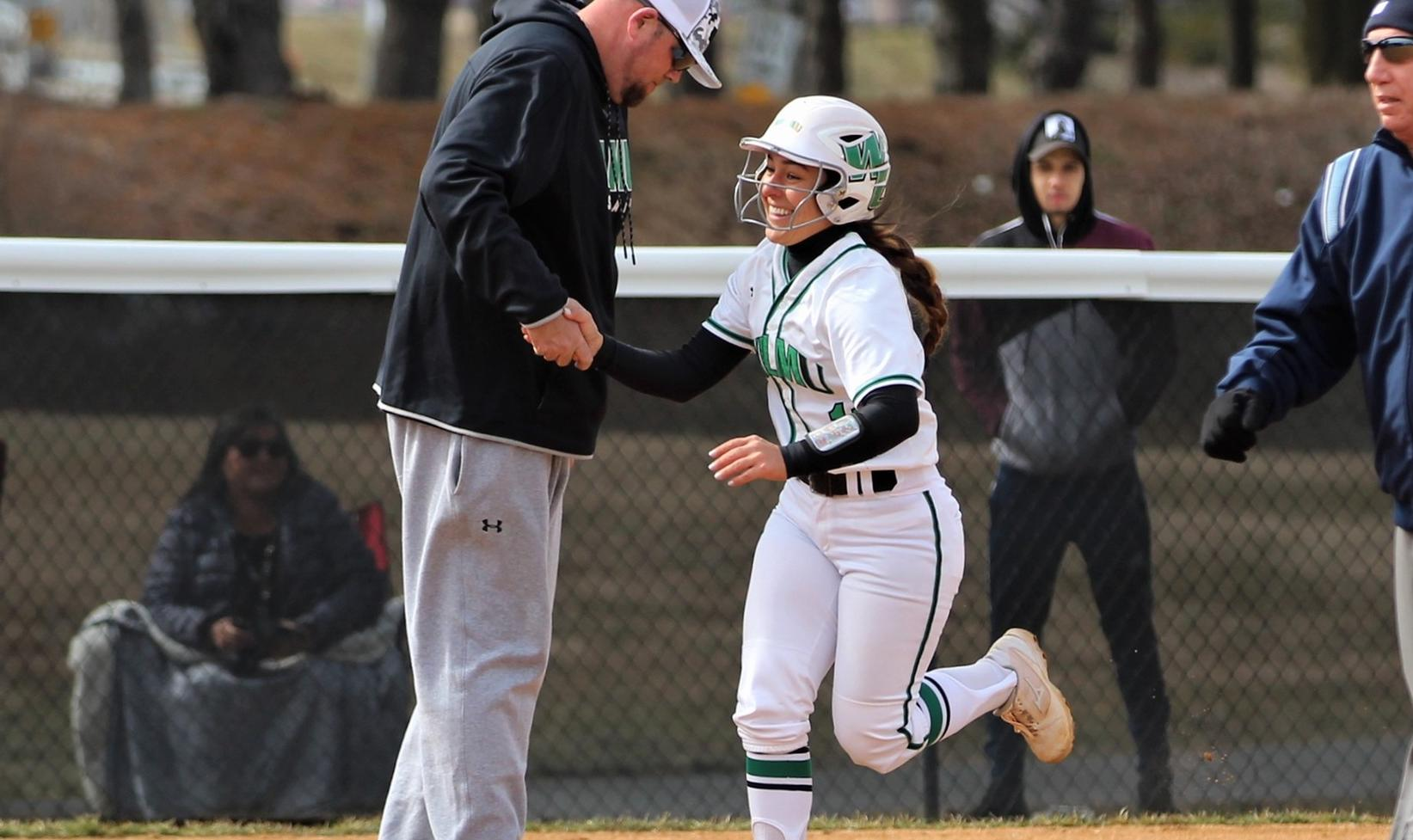 Copyright 2019; Wilmington University. All rights reserved. Photo of Annie Davila greeting assistant coach Rich Groff after one of her two home runs on Wednesday. Photos by Keara McCarthy. March 13, 2019 vs. Shippensburg.