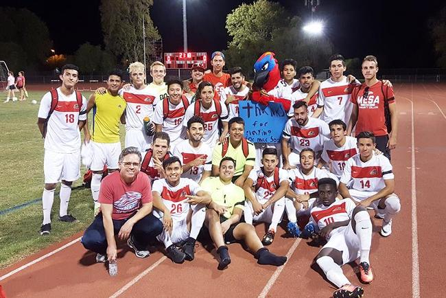The men's soccer team poses after its 3-0 victory over Paradise Valley.