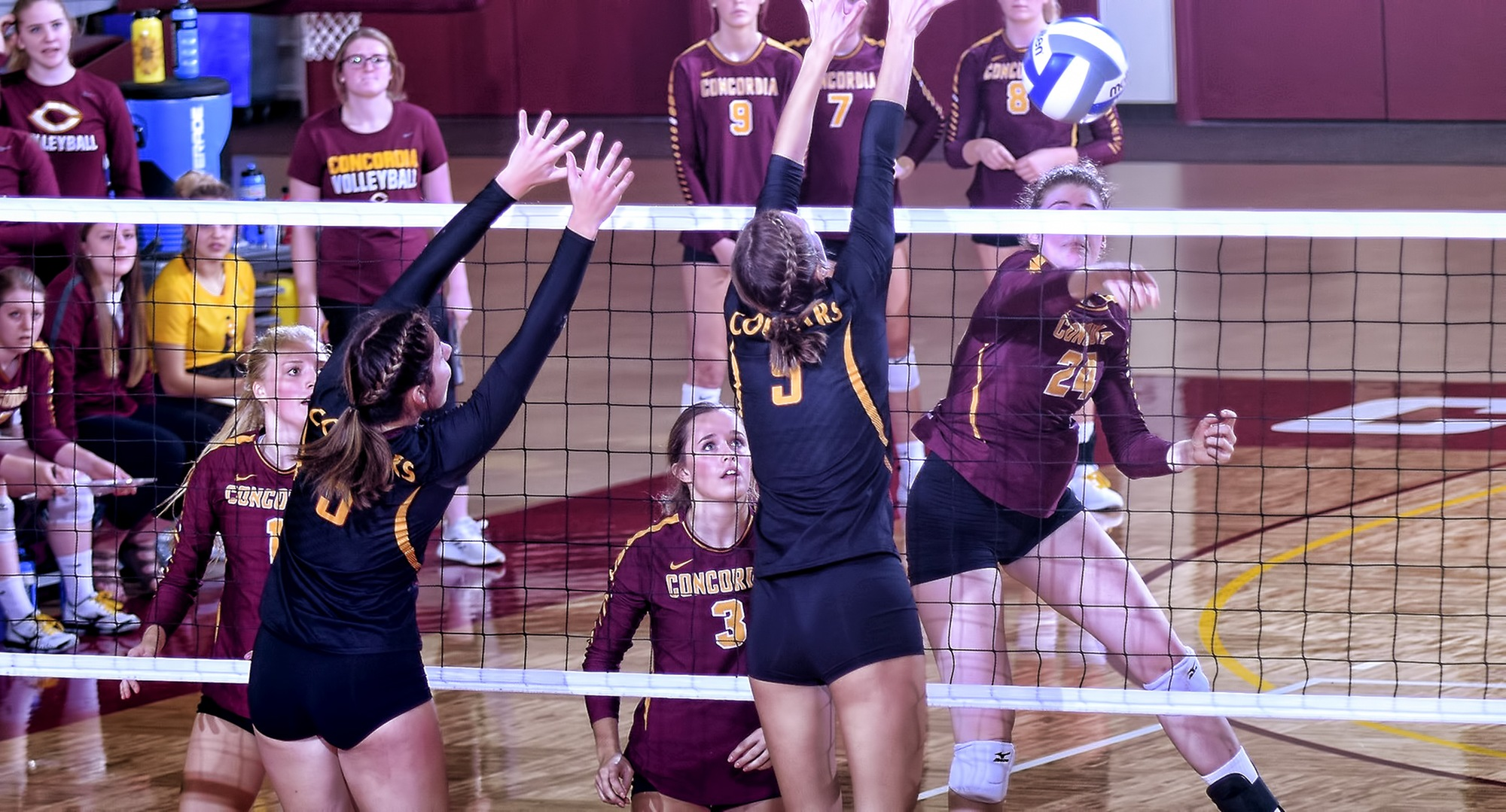 Sophomore Kendra Wiggs pushes the ball past the block in the third set of the Cobbers' non-conference match with Minn.-Morris.