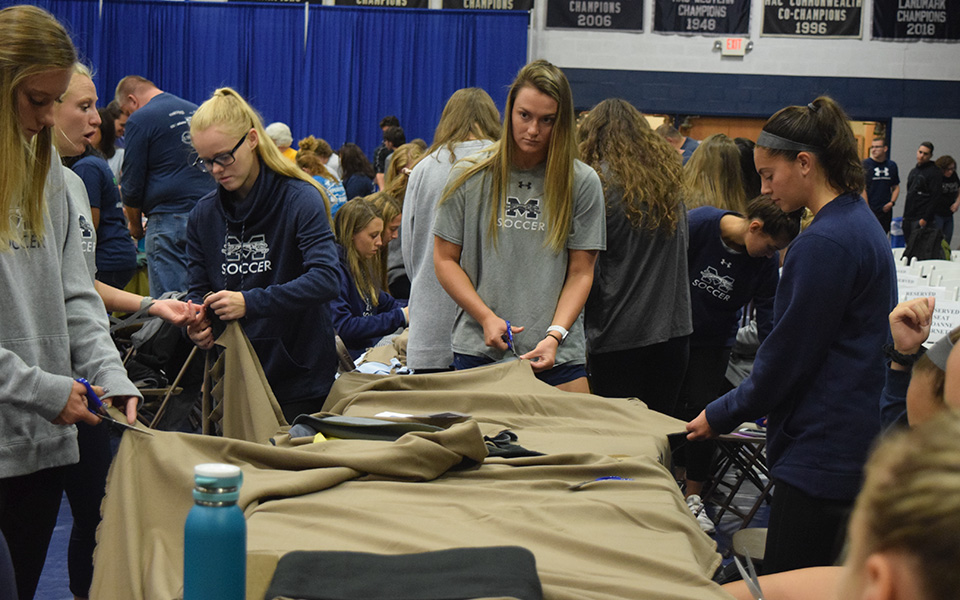 Members of the women's soccer team make blankets during Moravian's 4th Annual Heritage Day.