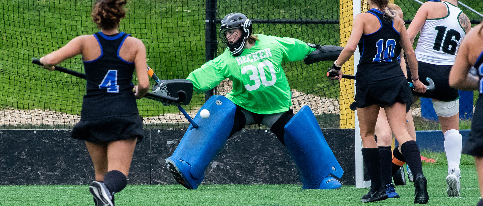 Victoria Pilpel of the field hockey team making a save in net