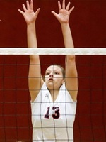 Kaite Williams blocks a ball.