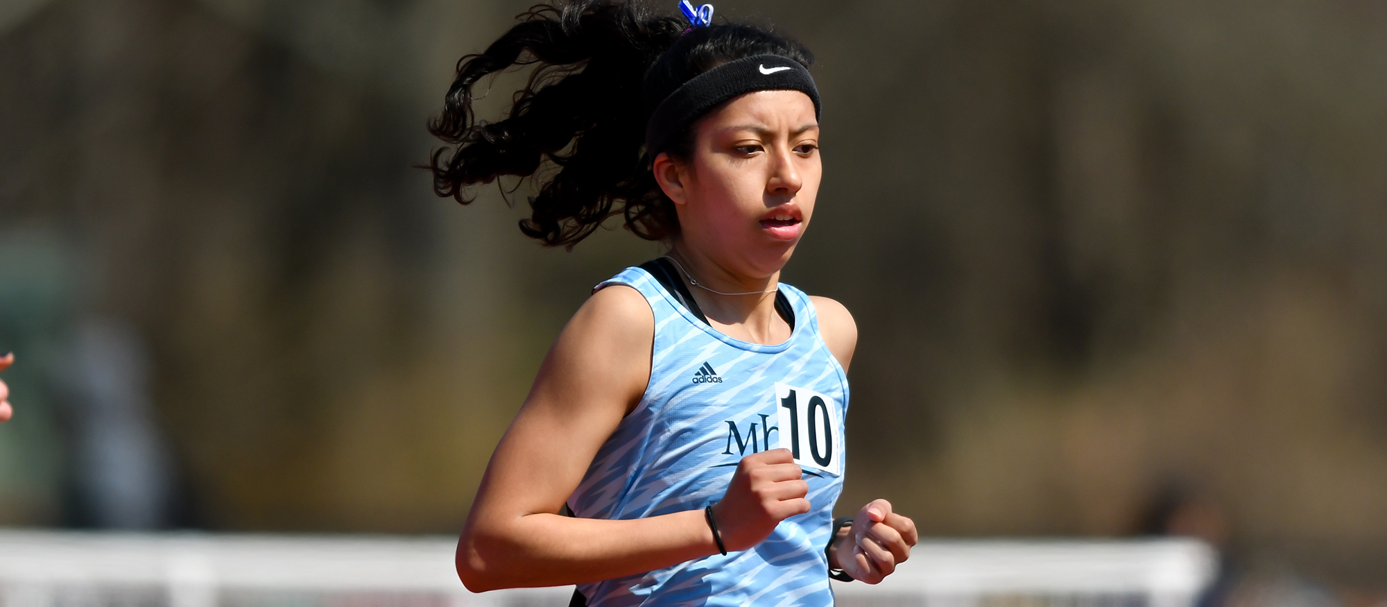 Action photo of Lyons track & field athlete, Michelle Serrano.