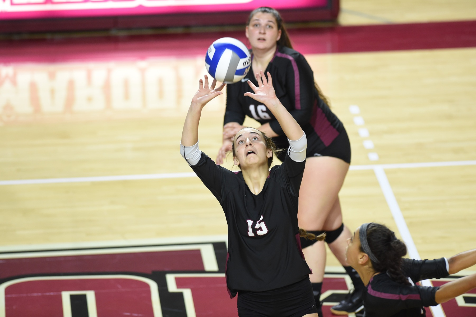 action photo of Roanoke volleyball player Olivia Newman setting the ball