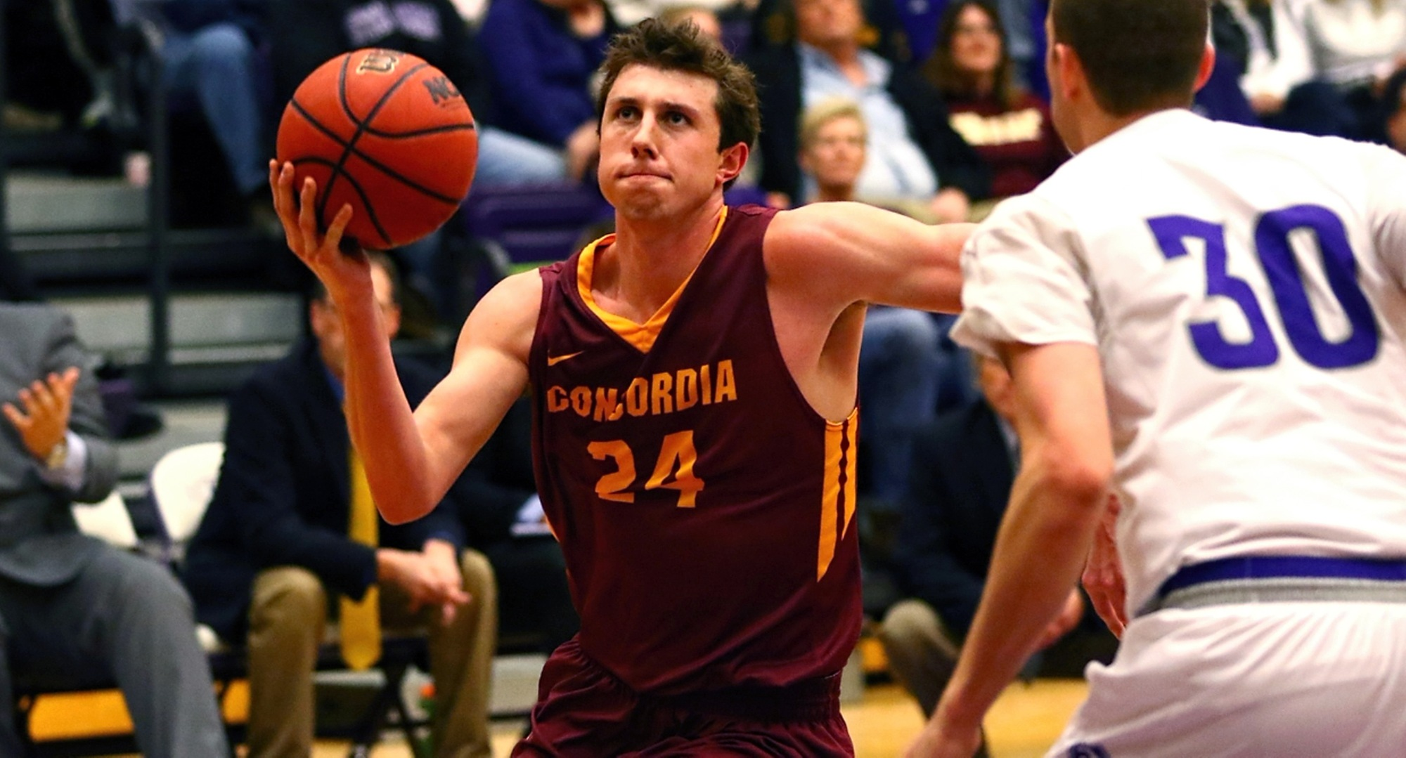 Senior Austin Nelson drives to the basket for two of his team-high 13 points in the Cobbers' game at St. Thomas (Photo courtesy of Ryan Coleman, d3photography.com)