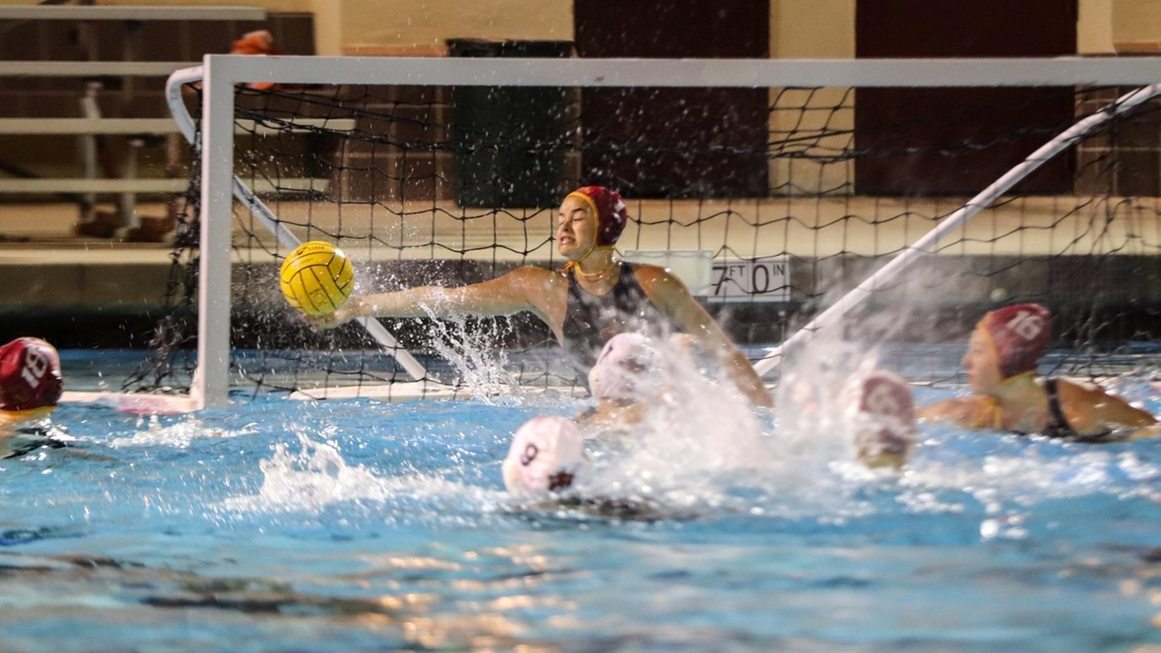 Jessica Salaz with one of her seven saves in the win over Occidental (photo by Daniel Addison)