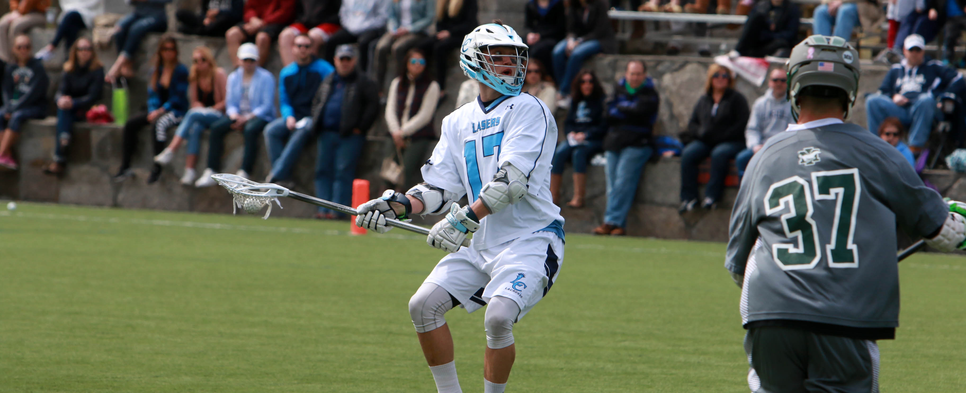 Lasers Contend with Roger Williams; Drop 13-12 Decision