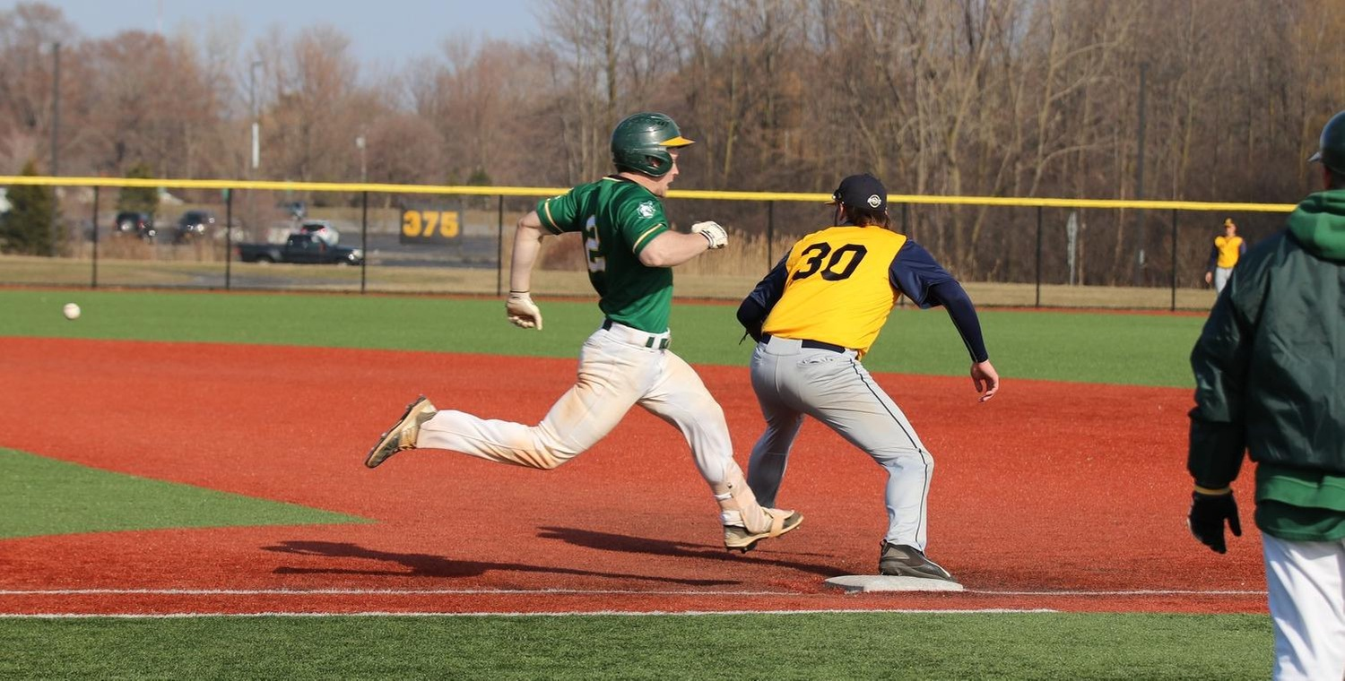Sean Sheets (2) beats out an infield single for the Wolves