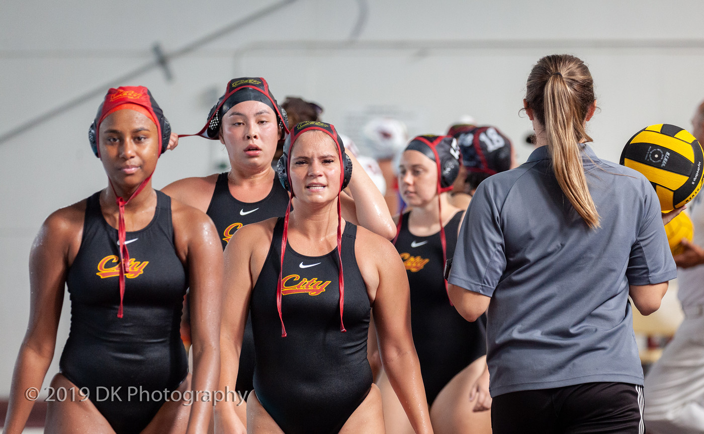 City College's Martha Shrader (left), Kealani Burke (center) and Isabella Pfeffer (right) react after the close match against Fresno City College at the Hoos Pool on Sept. 18th.