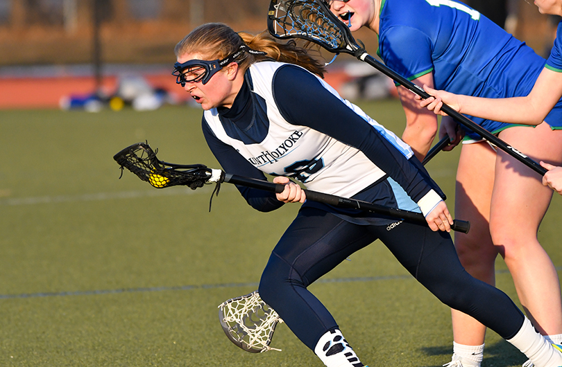 Action photo of Lyons lacrosse player, Morgan Tanguay.