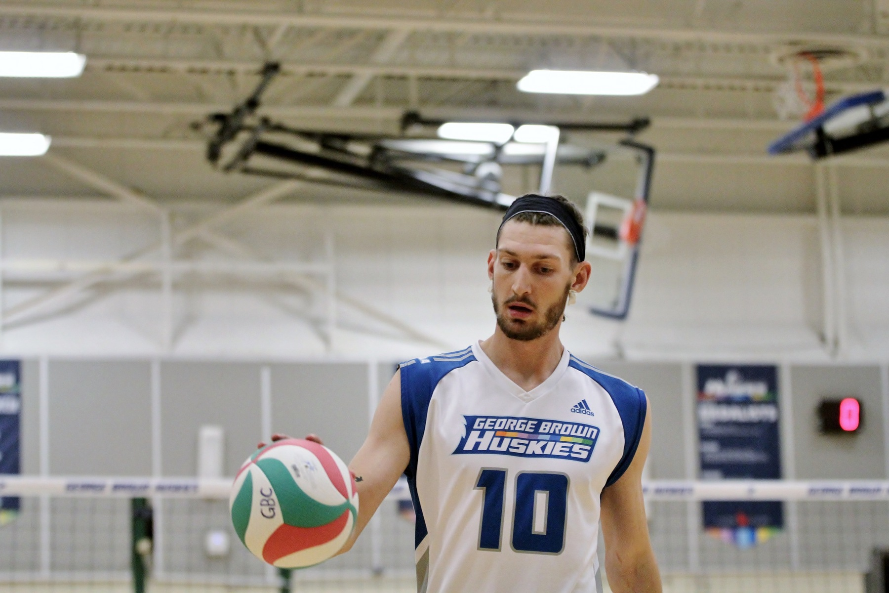 Men's volleyball player with ball in hand