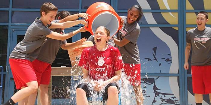 Gallaudet coach Stephanie Stevens gets water poured on her for charity