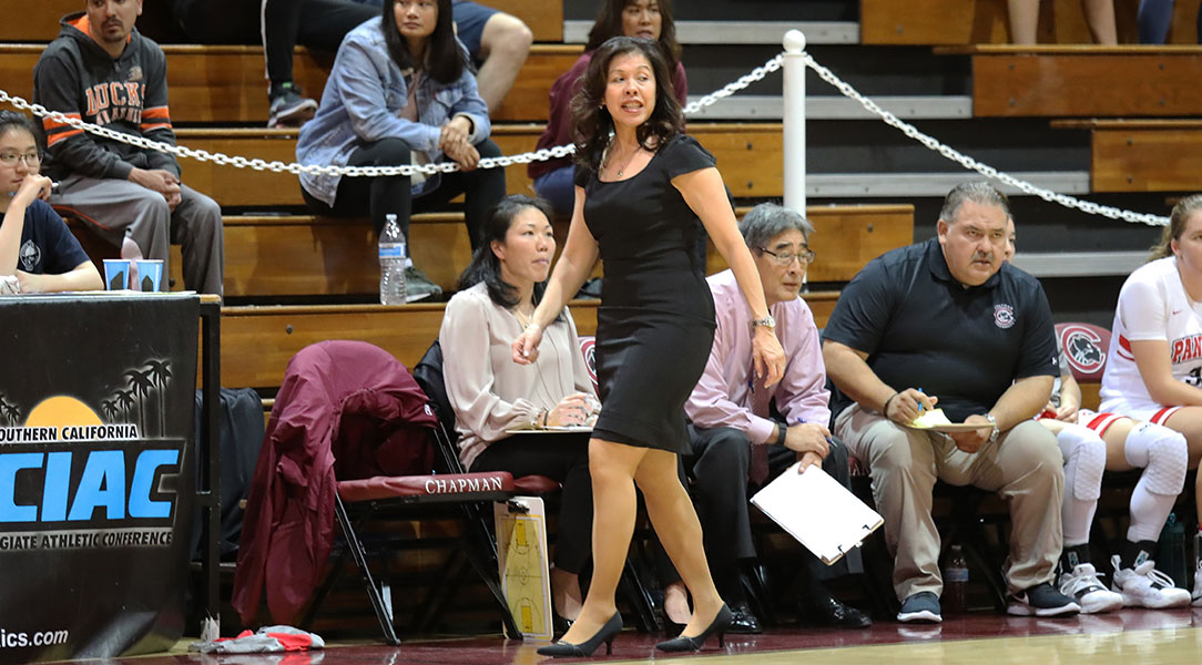 Carol Jue walks on the sideline during a game.