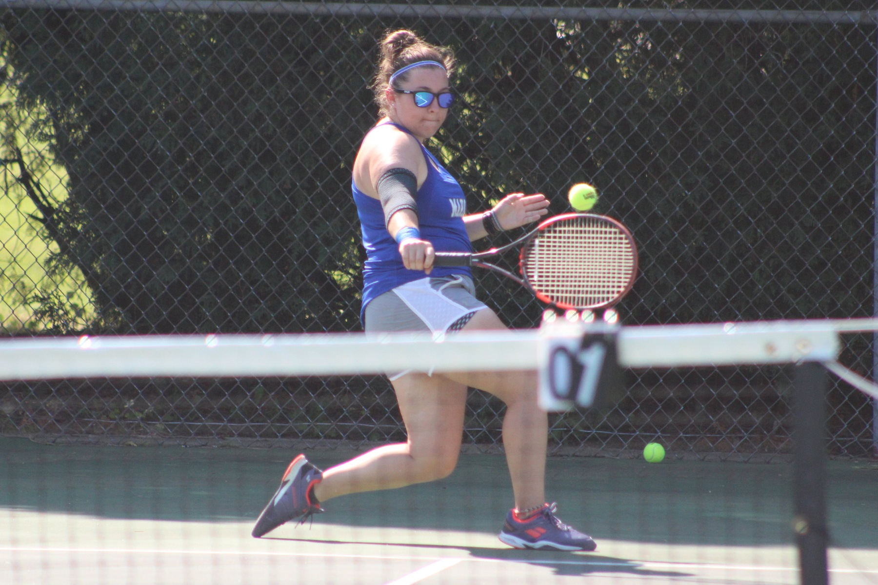 Kristin Houle uses her backhand.