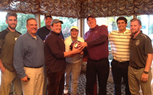 The winners of the men's basketball golf outing celebrate with the Royals' seniors.