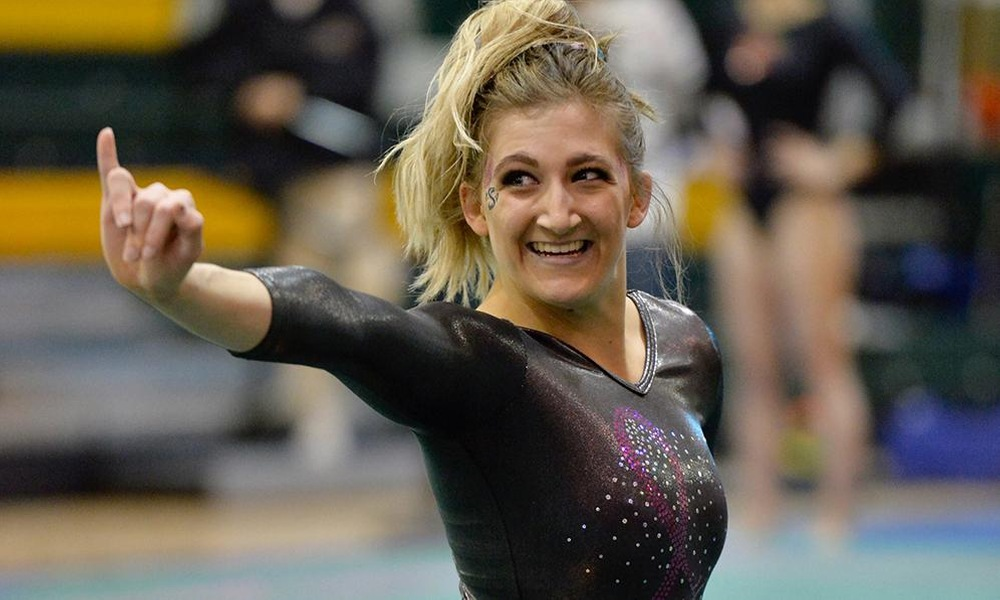 GYMNASTICS SCORES 194.075 TO RECORD TWO ROAD VICTORIES