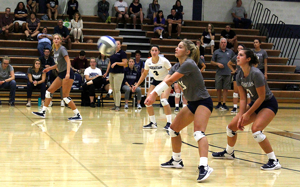 Freshman Gabby Mancini gets set to dig a ball versus DeSales University in Johnston Hall.