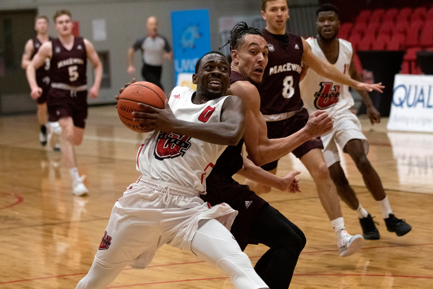 Wesmen guard DJ Dixon is fouled on his way to a lay-up during men's basketball action against the MacEwan Griffins on Friday, Jan. 10, 2020. (David Larkins/Wesmen Athletics)