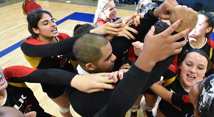 Head Coach German Del Valle and the Eagles celebrate after winning their first match in the state tournament. (Photo by Tom Hagerty, Polk State.)